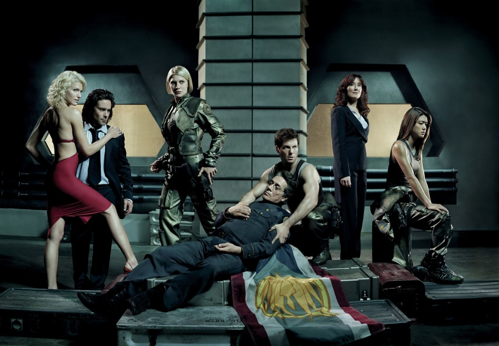 "BATTLESTAR GALACTICA -- SCI FI Series -- Pictured: (l-r) Tricia Helfer as Number Six, James Callis as Gauis Baltar, Katee Sackhoff as Lt. Kara ""Starbuck"" Thrace, Edward James Olmos as Commander Adama, Mary McDonnell as President Laura Roslin, Jamie Bamber as Lee ""Apollo"" Adama, Aaron Douglas as Tyrol, Grace Park as Sharon ""Boomer"" Valeri -- SCI FI Photo: Anthony Mandler"